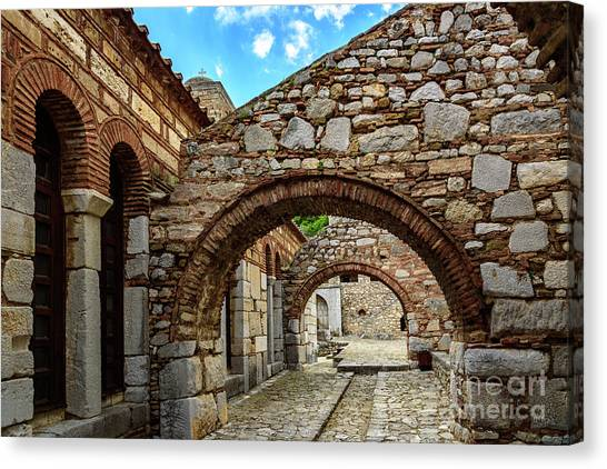 St Kyriaki Canvas Print - Stone Arches And Walkway At Monastery Of Hosios Loukas In Greece by Global Light Photography - Nicole Leffer