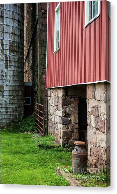 Stone Barn With Milk Can Canvas Print