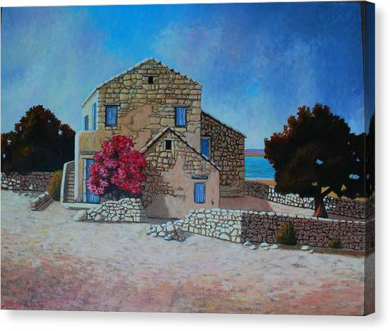 Stone House On The Beach Canvas Print by Santo De Vita