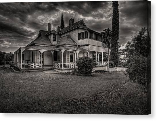 Storm Clouds Over Old House Canvas Print
