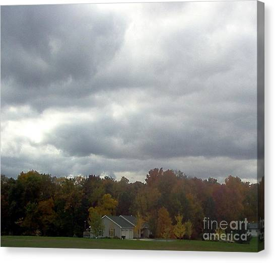 Storms A Brewin' Canvas Print by Emily Kelley