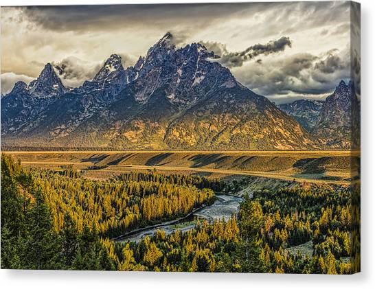 Stormy Sunrise Over The Grand Tetons And Snake River Canvas Print