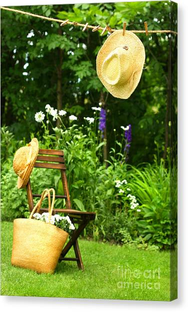 Straw Hat Hanging On Clothesline Canvas Print