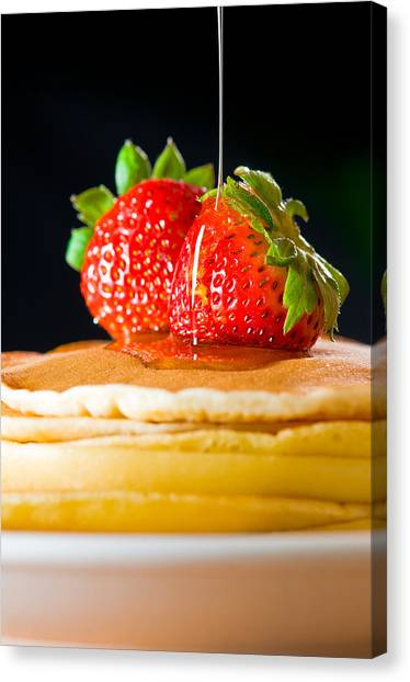 Strawberry Butter Pancake With Honey Maple Sirup Flowing Down Canvas Print