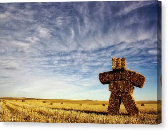Strawman On The Prairies Canvas Print