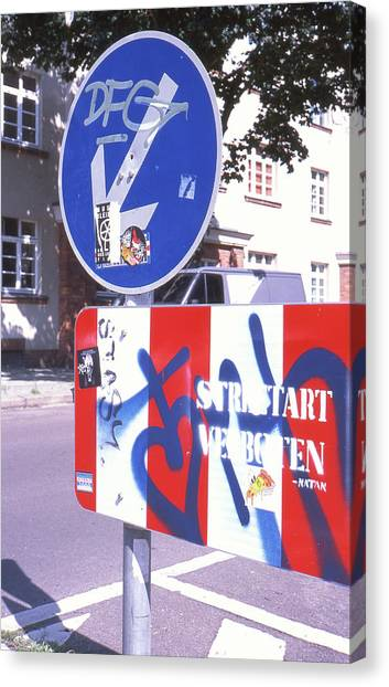 Street Art In Street Sign Canvas Print
