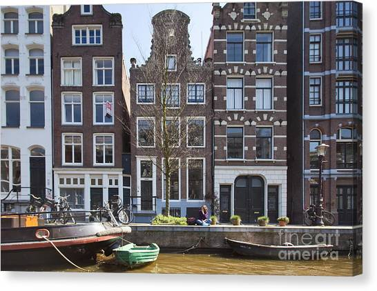 Streets And Channels Of Amsterdam Canvas Print by Andre Goncalves