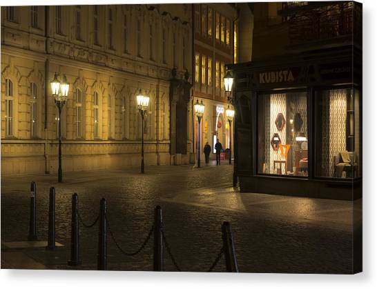 Stroll In Prague's Evening Canvas Print by Marek Boguszak