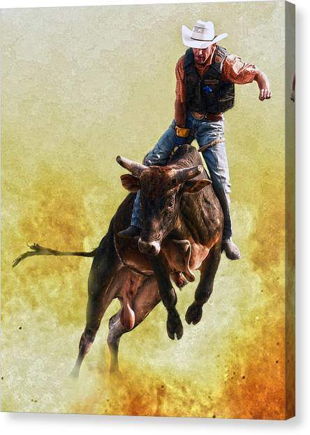 Bull Riding Canvas Print - Strong Heart by Ron  McGinnis