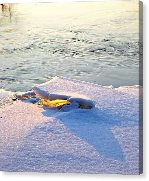 Sun And Ice Canvas Print by Robert Pearson