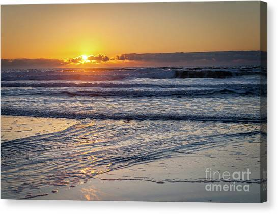Sun Behind Clouds With Beach And Waves In The Foreground Canvas Print