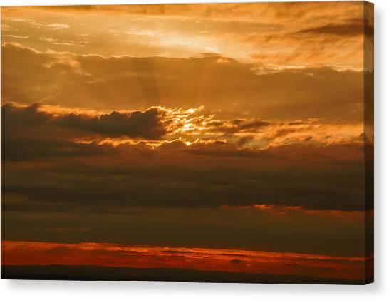 Sun Behind Dark Clouds In Vogelsberg Canvas Print