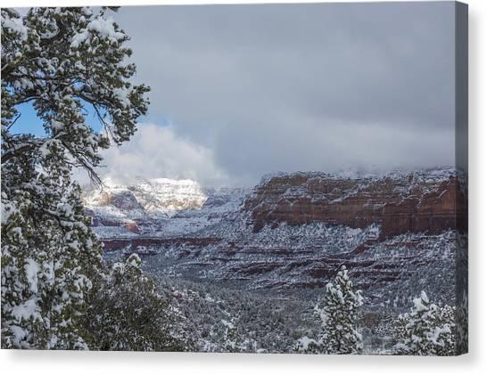 Sunlit Snowy Cliff Canvas Print