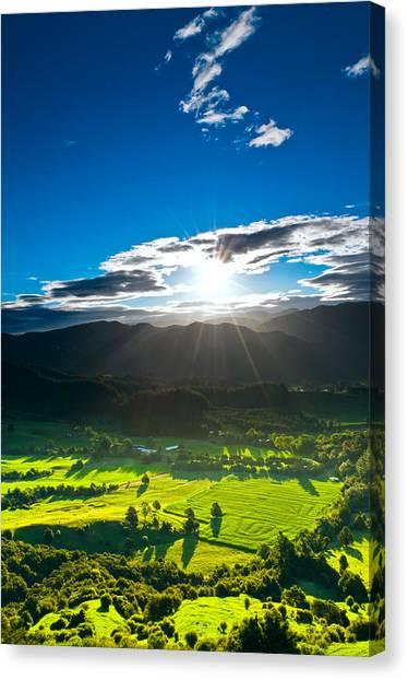 Sunrays Flood Farmland During Sunset Canvas Print