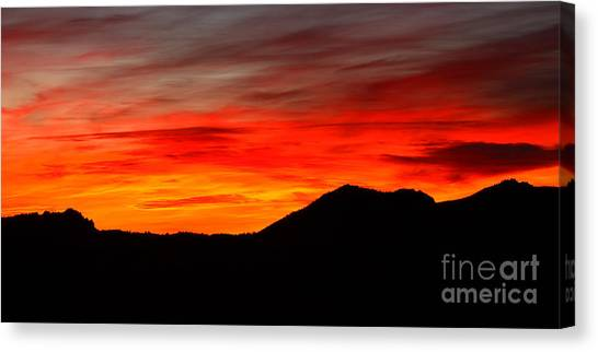 Sunrise Against Mountain Skyline Canvas Print