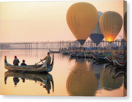 Sunrise At U Bein Bridge  Canvas Print by Anek Suwannaphoom