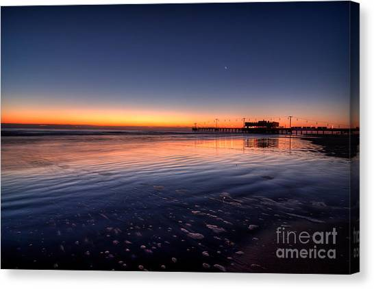 Sunrise On The Beach Canvas Print by Michael Herb