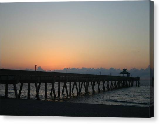 Sunrise Pier Canvas Print by Dennis Curry