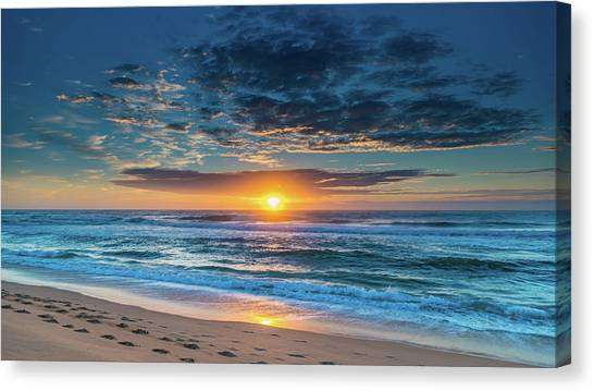 Sunrise Seascape With Footprints In The Sand Canvas Print