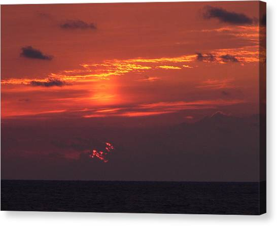 Sunrising Out Of Clouds Canvas Print by Tom LoPresti