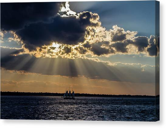 Sunset And A Three Masted Schooner Canvas Print