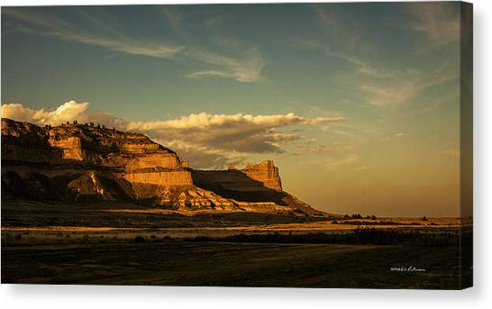 Canvas Print featuring the photograph Sunset At Scotts Bluff National Monument by Edward Peterson