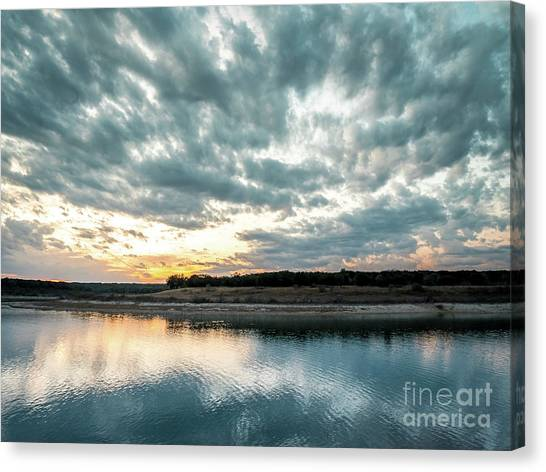 Sunset Behind Small Hill With Storm Clouds In The Sky Canvas Print