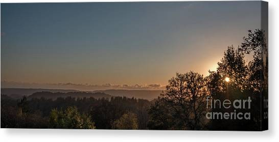 Sunset Behind Tree With Forest And Mountains In The Background Canvas Print