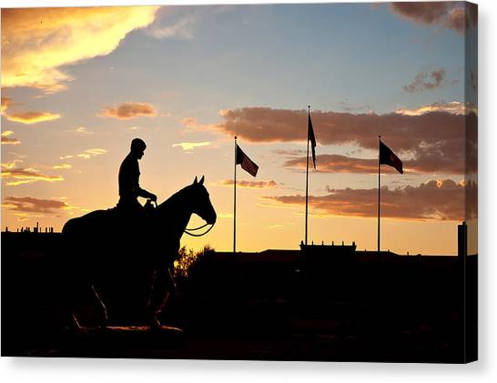 Texas Tech University Canvas Print - Sunset Behind Will Rogers And Soapsuds Statue At Texas Tech University In Lubbock by Ilker Goksen