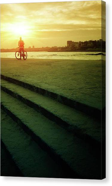 Backpacks Canvas Print - Sunset Bicycle Ride by Carlos Caetano