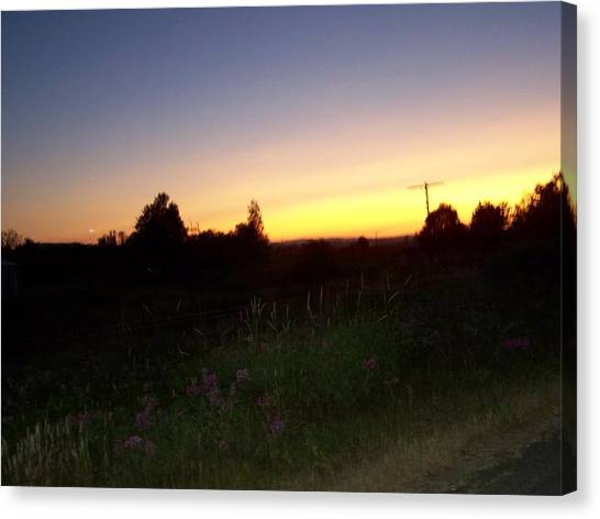 Sunset Haze Canvas Print by Laurie Kidd