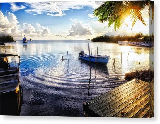 Sunset In A Fishing Village Canvas Print by George Oze