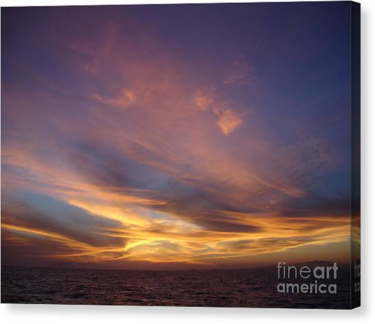 Sunset Over Island Canvas Print by Chad Natti