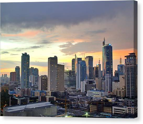 Sunset Over  Makati City, Manila Canvas Print by Neil Howard