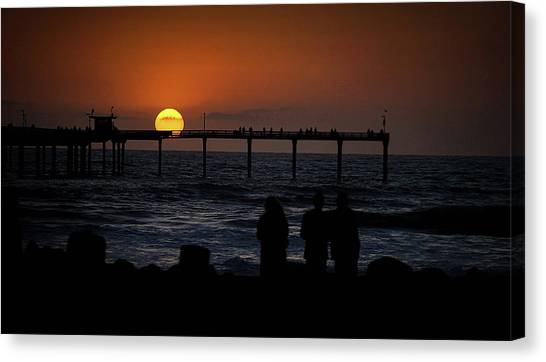 Sunset Over The Pier Canvas Print