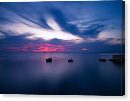 Canvas Print featuring the photograph Sunset Over The Sea by Mirko Chessari