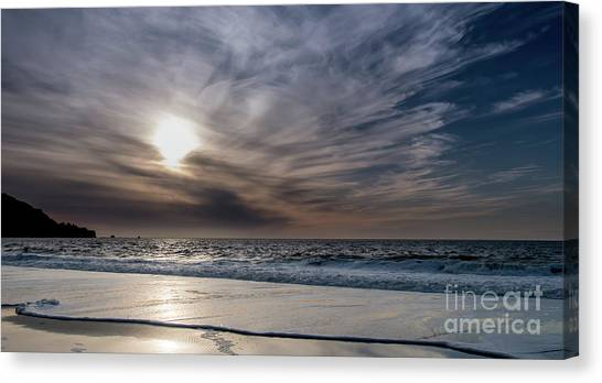 Sunset Over West Coast Beach With Silk Clouds In The Sky Canvas Print