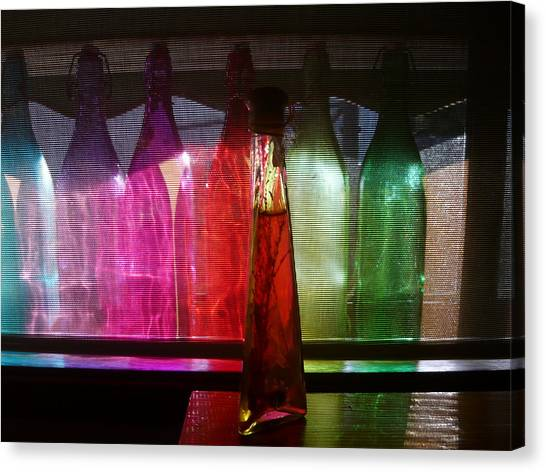 Sunset Through Glass Bottles Canvas Print by Adrianne Wood