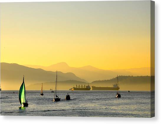 Sunset With Green Sailboat Canvas Print