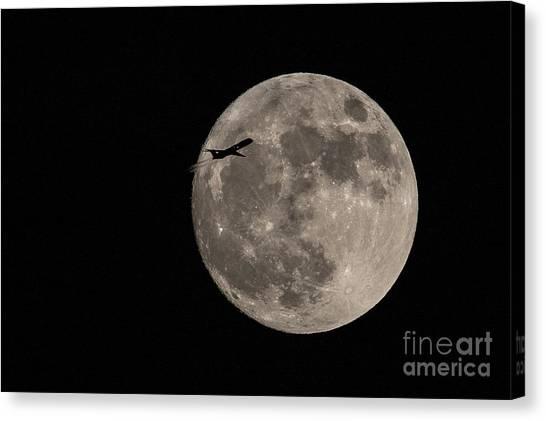 Super Moon And Plane Canvas Print by Jennifer Ludlum