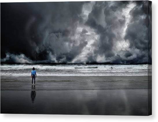 Surfer And An Angry Sky Canvas Print