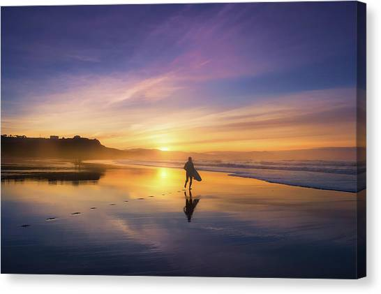 Surfer In Beach At Sunset Canvas Print
