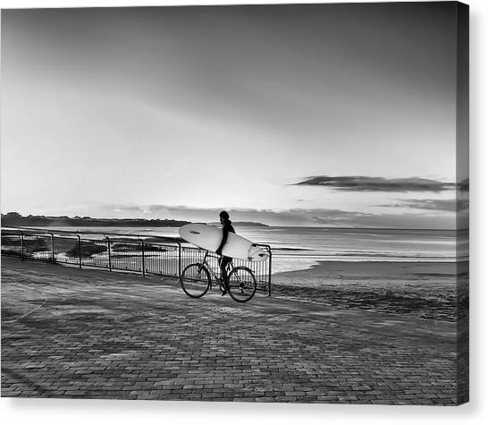 Surfer On A Bike Canvas Print