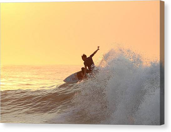 Canvas Print featuring the photograph Surfing In Golden Sky by Robert Banach
