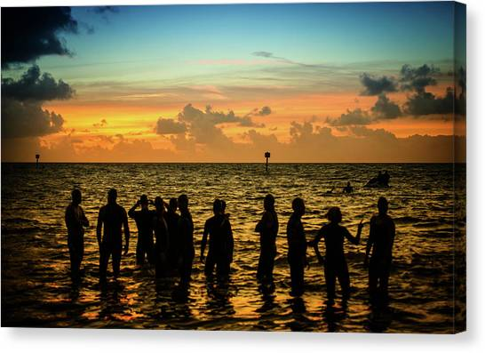 Swimmers Sunrise Canvas Print