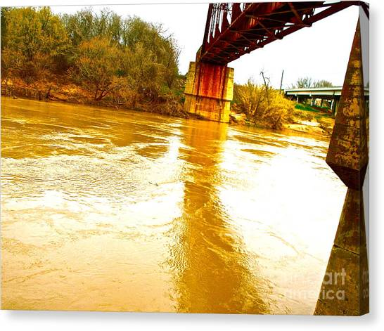 Swirling Good Water And Brazos Bridge Canvas Print by Chuck Taylor