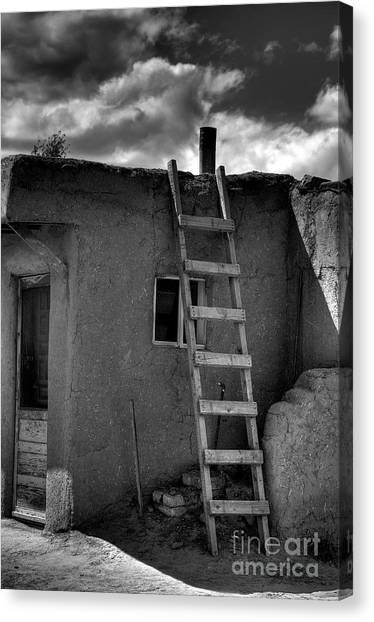 Taos Adobe And Ladder Canvas Print by David Waldrop