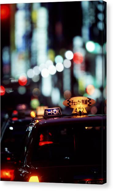 Taxis On The Ginza Canvas Print by Brad Rickerby