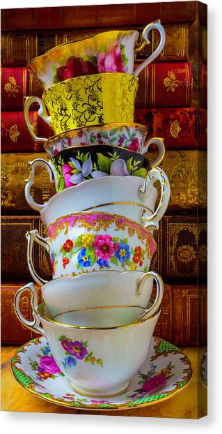 Tea Time Canvas Print - Tea Cups Stacked Against Old Books by Garry Gay