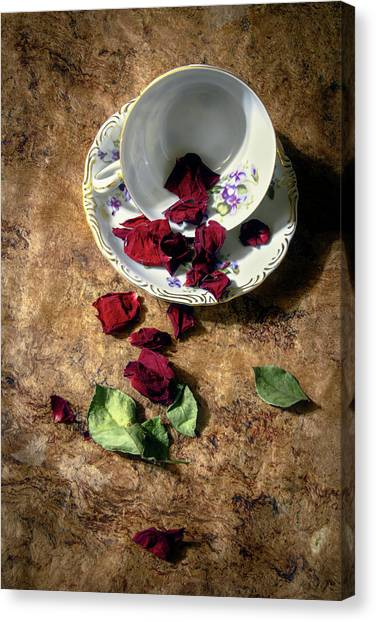 Teacup And Red Rose Petals Canvas Print